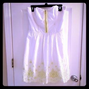 White strapless dress with neon green embroidery